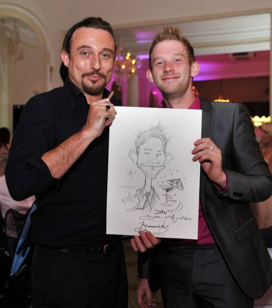 Caricaturist with guest